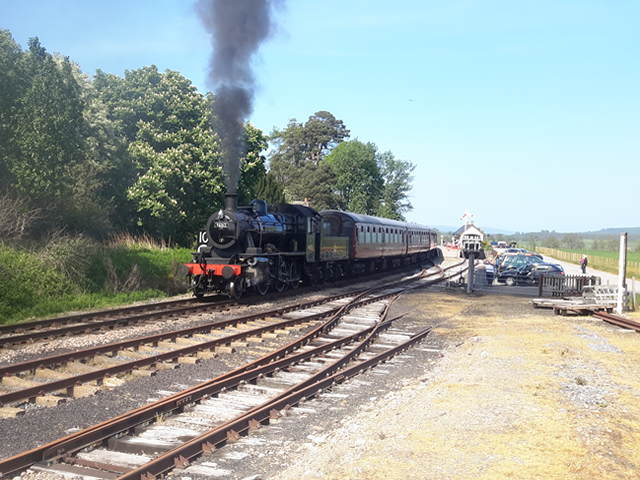 Steam Train leaving Nethybridge Station heading for Aviemore, Scotland